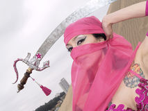 Arab dance pose with a sabre on the head, close-up Stock Photography