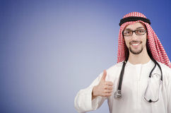 Arab doctor in studio. Shooting Stock Images