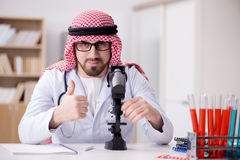 The arab doctor working in the lab hospital Royalty Free Stock Photos