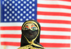 Arab doll with American Flag in the background Stock Photo