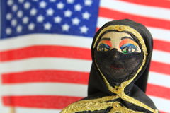 Arab doll with American Flag in the background Royalty Free Stock Photos