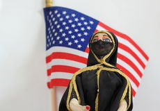 Arab doll with American Flag Royalty Free Stock Image