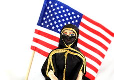 Arab doll with American Flag Stock Image