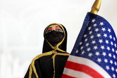 Arab doll with American Flag Stock Photo