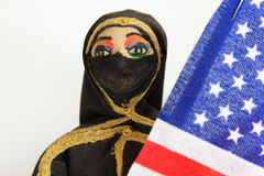 Arab doll with Burka holding American Flag Stock Photo
