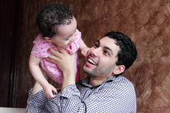Arab egyptian baby girl playing with her father Stock Photo