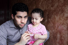 Arab egyptian man with his baby girl Royalty Free Stock Images