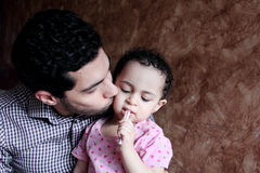 Arab egyptian man or father kissing his baby girl Royalty Free Stock Images