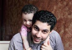 Arab egyptian man lifting his baby girl Stock Image