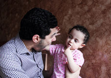 Arab egyptian man playing with his baby girl Royalty Free Stock Photography