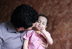 Arab egyptian man playing with his baby girl Stock Photography