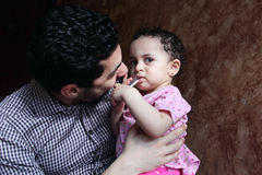 Arab egyptian man playing with his baby girl Stock Photo