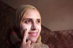 Arab egyptian muslim woman applying facial mask Stock Photo