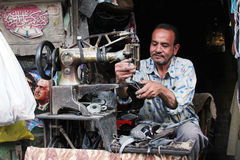 Arab egyptian shoemaker Stock Image
