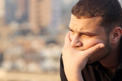 Arab egyptian young businessman thinking feeling despair Stock Images