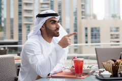 Arab Emirati Man Looking Forward and Pointing Finger Royalty Free Stock Photography