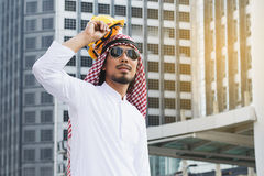 Arab Engineer construction worker holding helmet construction Stock Photos