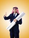 Arab engineer with drawings against gradient Stock Image