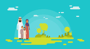Arab Family Four People, Arabic Parents Two Children Nature Background Stock Photos