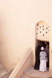 Arab Family Scene. A Muslim family enters an old fort in the middle east Stock Image