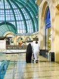 Arab family shopping in supermarket in Dubai. UAE stock image