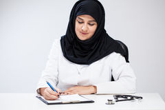 Arab female doctor noting Royalty Free Stock Images