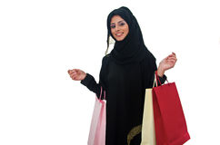 Arab Female Shopping. Arab female smiling and carrying shopping bags on white background Stock Images
