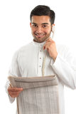 Arab financial businessman or stockbroker. An ethnic italian / arab mixed race businessmanwearing traditional middle eastern clothing.  He is on the telephone Royalty Free Stock Image