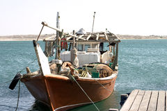 Arab fishing dhow. A traditional Arab fishing dhow, tied up at the quay in Waqrah, Qatar Royalty Free Stock Images