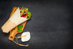 Arab Food Shawarma. Arab Traditional Food, Shawarma Rolled Sandwich with Sauce on Copy Space Area stock image