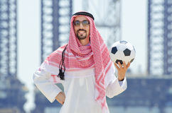 Arab with footbal at seaside Royalty Free Stock Image