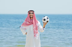 Arab with footbal at seaside Royalty Free Stock Photography