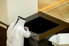 Arab gentleman looking at his phone Stock Image