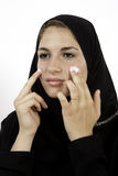 Arab Girl Applying Cream Royalty Free Stock Photography