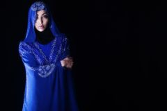 Arab girl, blue hijab Stock Photos