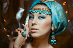 Arab girl in blue turban with gold jewelery Royalty Free Stock Photography