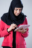 Arab girl using tablet Stock Image