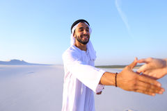 Arab guy advertising agent looking at camera tells information a Royalty Free Stock Photography