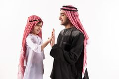 Arab happy father gives five little sons stock photo