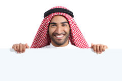 Arab happy saudi man displaying a banner sign. Isolated on a white background Royalty Free Stock Photos