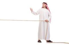 Arab i dragkampbegrepp Fotografering för Bildbyråer