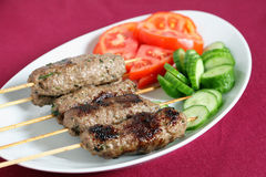 Arab lamb kofta on a plate Royalty Free Stock Images