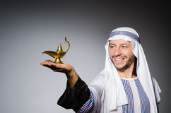 Arab with lamp Royalty Free Stock Photography