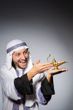 Arab with lamp Stock Photo