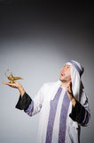 Arab with lamp Royalty Free Stock Image