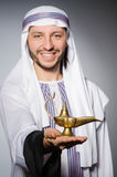 Arab with lamp Stock Image