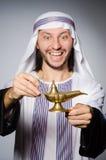 Arab with lamp Stock Photos