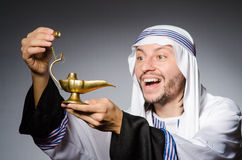 Arab with lamp Stock Images