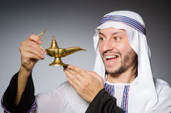 Arab with lamp Royalty Free Stock Photo