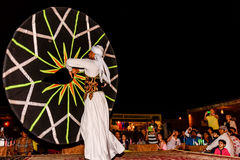 Arab male dancer performing in front of a crowd in Arabian deser Royalty Free Stock Images